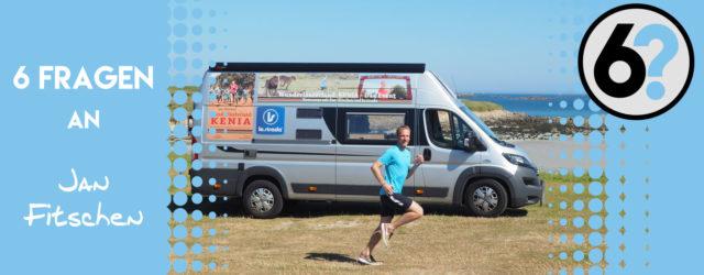 Titelbild zu 6 Fragen an Jan Fitschen mit Jan laufend vor seinem Wohnmobil